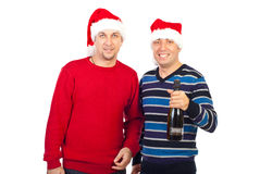 Two Xmas men holding champagne royalty free stock photography