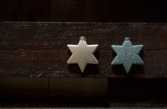 Two Xmass Stars. Two decoration for Christmass, one white and one blue with glitter Stock Images