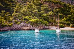 Two yacht in bay. Two yacht moored at bay in Oludeniz Turkey Stock Images
