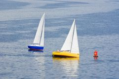 Two yacht making a turn near buoy Stock Photo