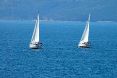 Two Yachts. Sailing at afternoon Royalty Free Stock Image