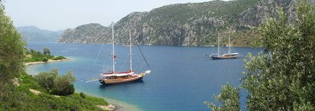 Two yachts in aegean sea panorama Stock Images