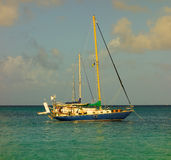 Two yachts anchored at princess margaret beach, bequia Stock Image
