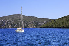 Two yachts in the bay of Aegean Sea. Royalty Free Stock Photo