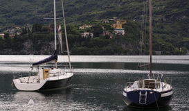 Two yachts on Bellagio sea front. On Lake Como royalty free stock images