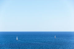 Two yachts on the high seas. Royalty Free Stock Images