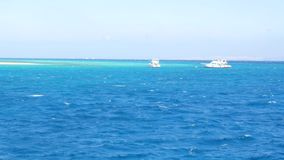 Two yachts not far from each other. The blue sea is spacious. Two yachts are not far from each other. You can see yachts on the horizon. Two yachts are quickly stock video