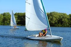 Two yachts race on river Royalty Free Stock Photo