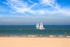 Two yachts racing near seashore Royalty Free Stock Photo