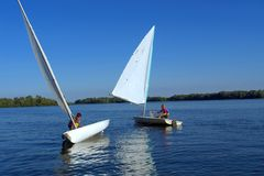 Two yachts on river Stock Images