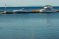 Two yachts in  sea at mooring Royalty Free Stock Photos
