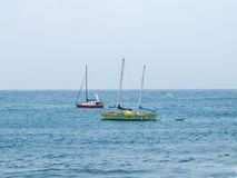 Red & Green Yachts Moored at Sea off Lanzarote stock photos