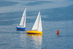 Two yachts turning of the sailing race on the Dnepr river Stock Photography