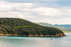Free Two Yahts Floating Near The Scenic Landscape Of Cala Violina Beach In Tyrrhenian Sea Bay Surrounded By Green Forest In Province Of Stock Image - 161708681