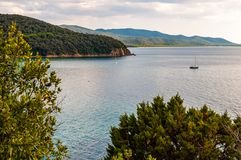 Free Two Yahts Floating Near The Scenic Landscape Of Cala Violina Beach In Tyrrhenian Sea Bay Surrounded By Green Forest In Province Of Stock Images - 161709254