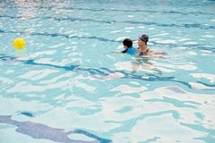 Two year boy at first swimming lesson with his mother. Two year asia boy at first swimming lesson with his mother Stock Images
