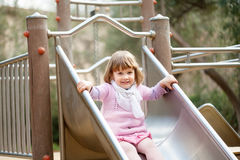 Two-year baby girl on slide Stock Image