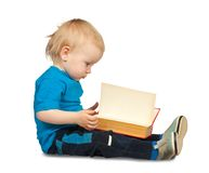 Two-year boy  with book Royalty Free Stock Photos