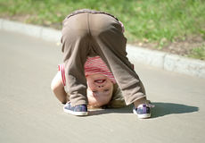 Two-year chid upside down. Two-year chid looks around, upside down Royalty Free Stock Photo
