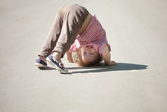 Two-year chid upside down. In park Royalty Free Stock Photos