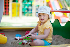 Two-year child playing in sandbox Stock Image
