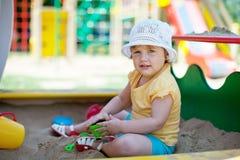 Two-year child playing in sandbox Stock Image