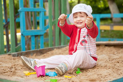 Two-year child  in sandbox Royalty Free Stock Photos