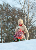 Two-year child sliding downhill on sledge Royalty Free Stock Photo
