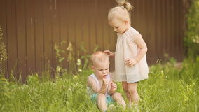 Two-year girl calming down her capricious brother stock footage