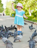 Two-year girl with doves Stock Photo