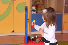 Two-year girl playing and learning in preschool Royalty Free Stock Photo