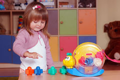 Two-year girl playing and learning in preschool Stock Images