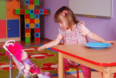 Two-year girl playing and learning in preschool Royalty Free Stock Photos