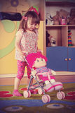 Two-year girl playing and learning in preschool Royalty Free Stock Photography
