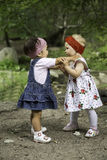 Two year-old adorable child girls playing on nature Stock Image