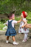 Two year-old adorable child girls playing on nature Stock Images