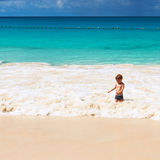 Two year old boy playing on beach Stock Photo