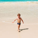 Two year old boy playing on beach Royalty Free Stock Photo