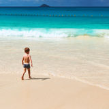 Two year old boy playing on beach Stock Photography