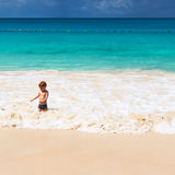 Two year old boy playing on beach Stock Image