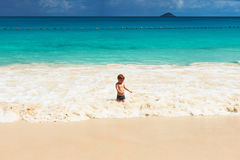 Two year old boy playing on beach Royalty Free Stock Image