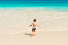 Two year old boy playing on beach Royalty Free Stock Photography