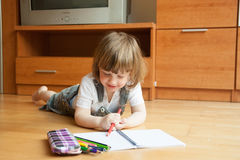 Two year-old girl drawing Stock Images