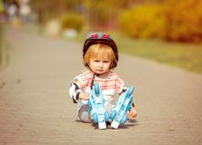 Two Year Old Girl In Roller Skates And A Helmet Stock Photography
