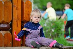 Two year old girl on  park bench Royalty Free Stock Photo