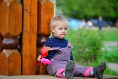 Two year old girl on  park bench Stock Image