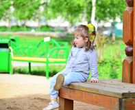 Two year old girl on  park bench Stock Photos
