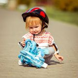Two year old  girl in roller skates and a helmet Royalty Free Stock Images