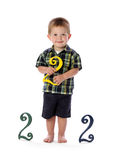 A Two Year Old Holds a Number Two. A young boy has a birthday and turns two years old stock photography