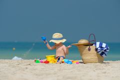 Two year old toddler playing on beach. Two year old toddler boy playing with beach toys on beach Royalty Free Stock Images